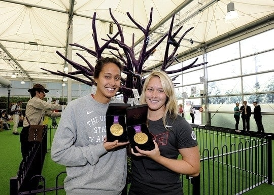 American water polo gold medal winners L to R Tumua Anau and Courney Matheson at the Heathrow games terminal before departing to the US. picture David Dyson