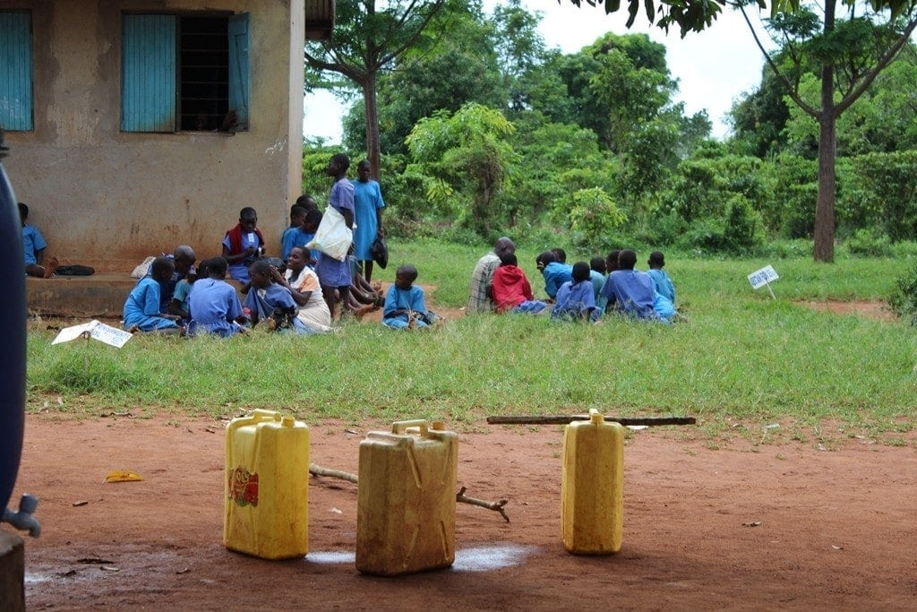 water on their heads daily routine women uganda