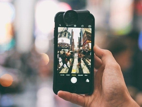 Smartphone taking photo of city scene