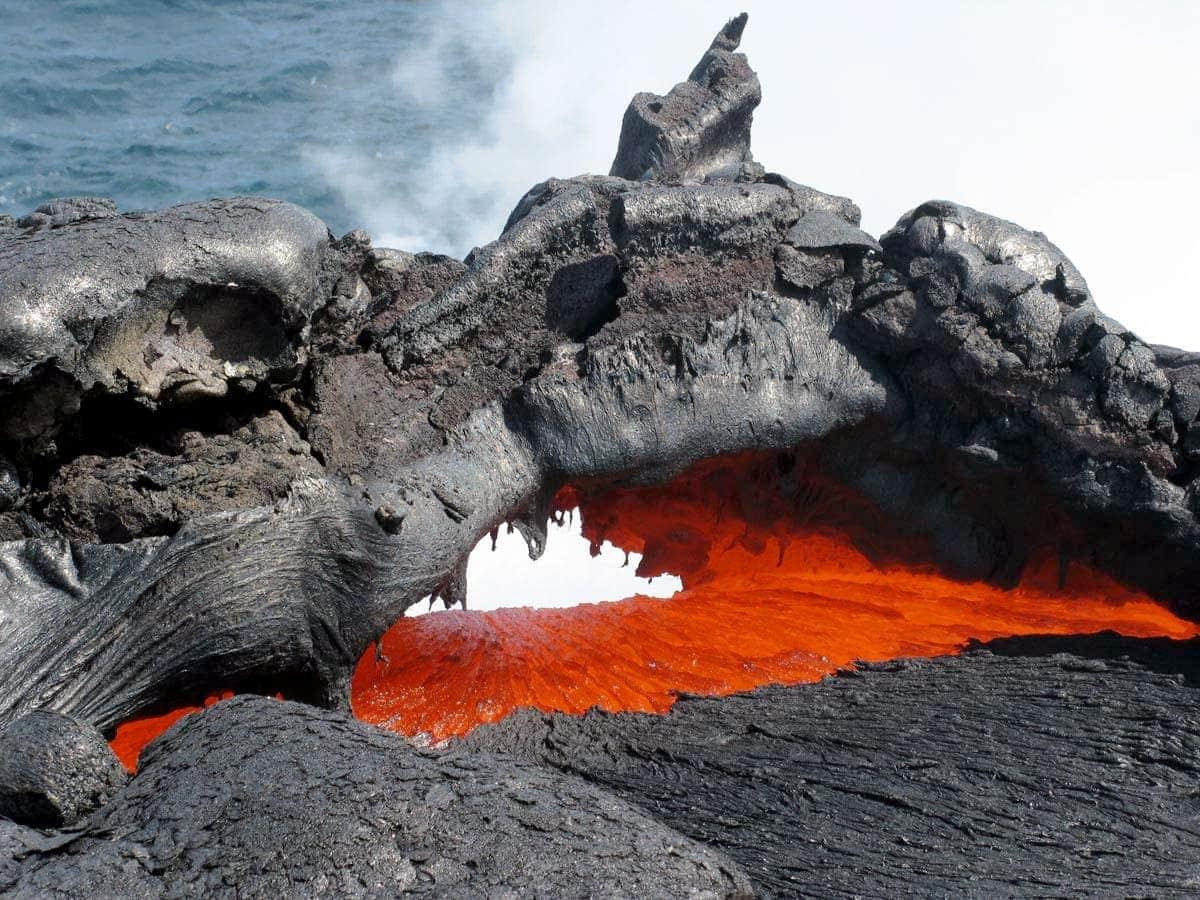 hawaiian volcanoes lava on road