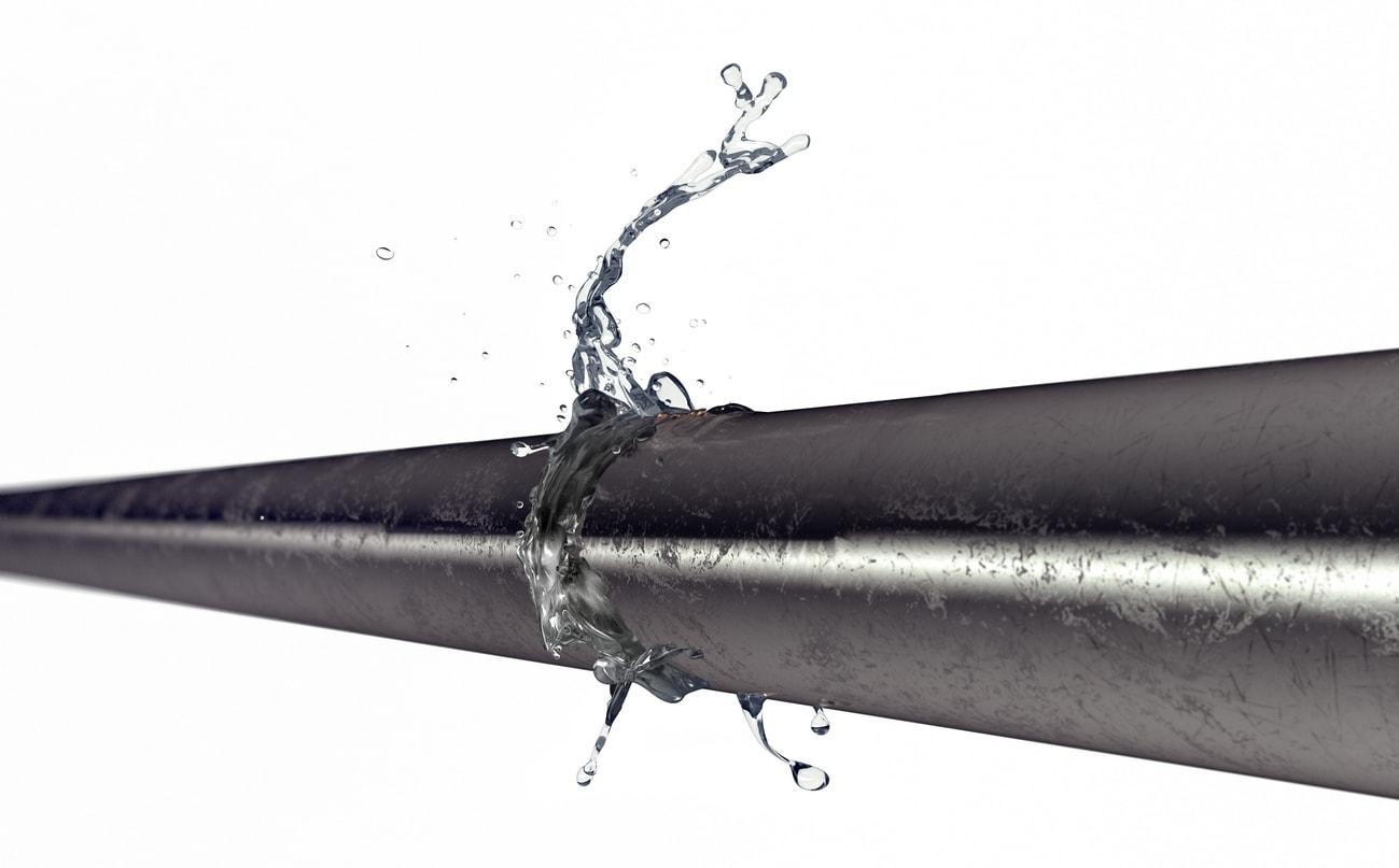 Ilustración de una tubería con una filtración de agua