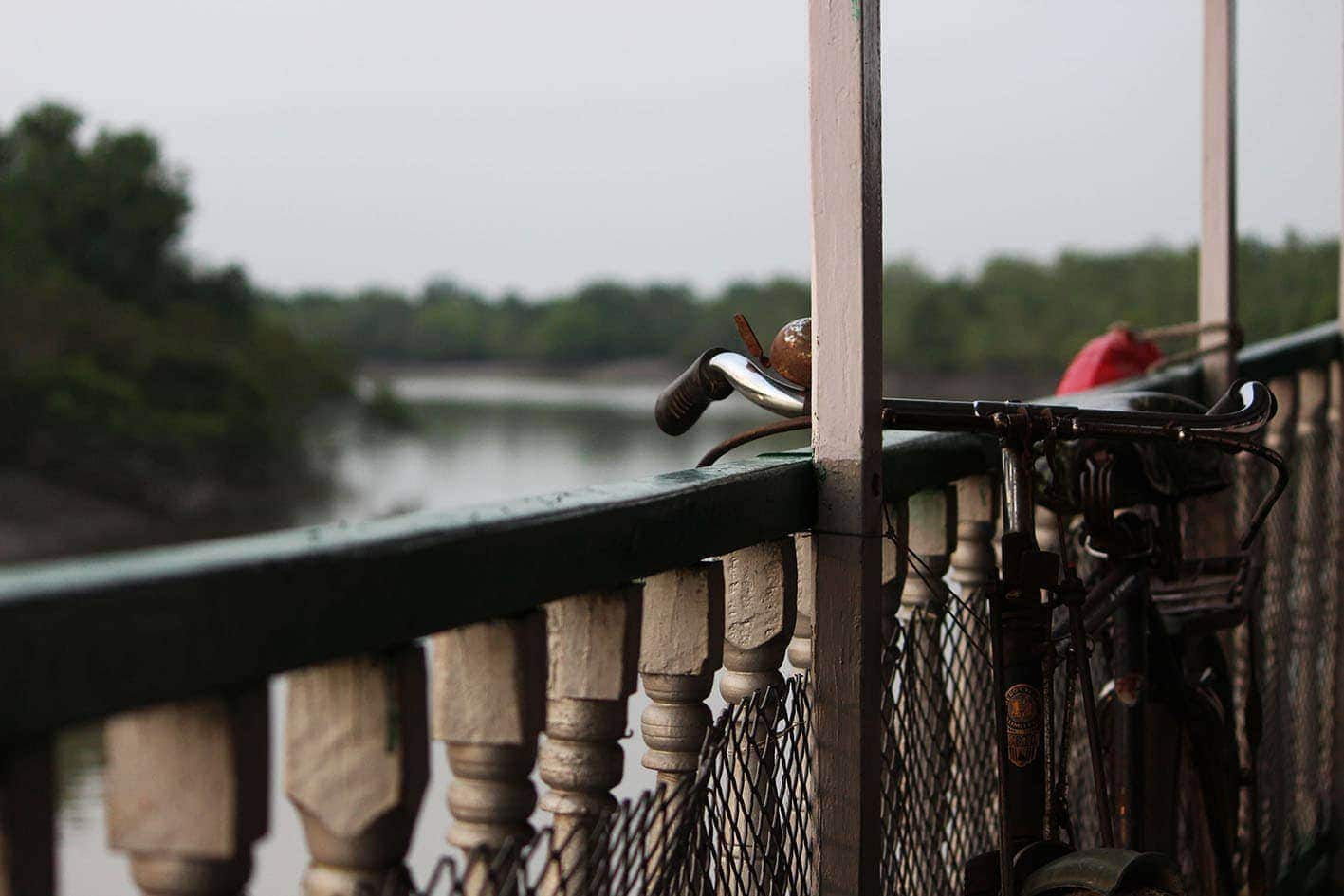 Image of a bike supports on the railing of a bridge