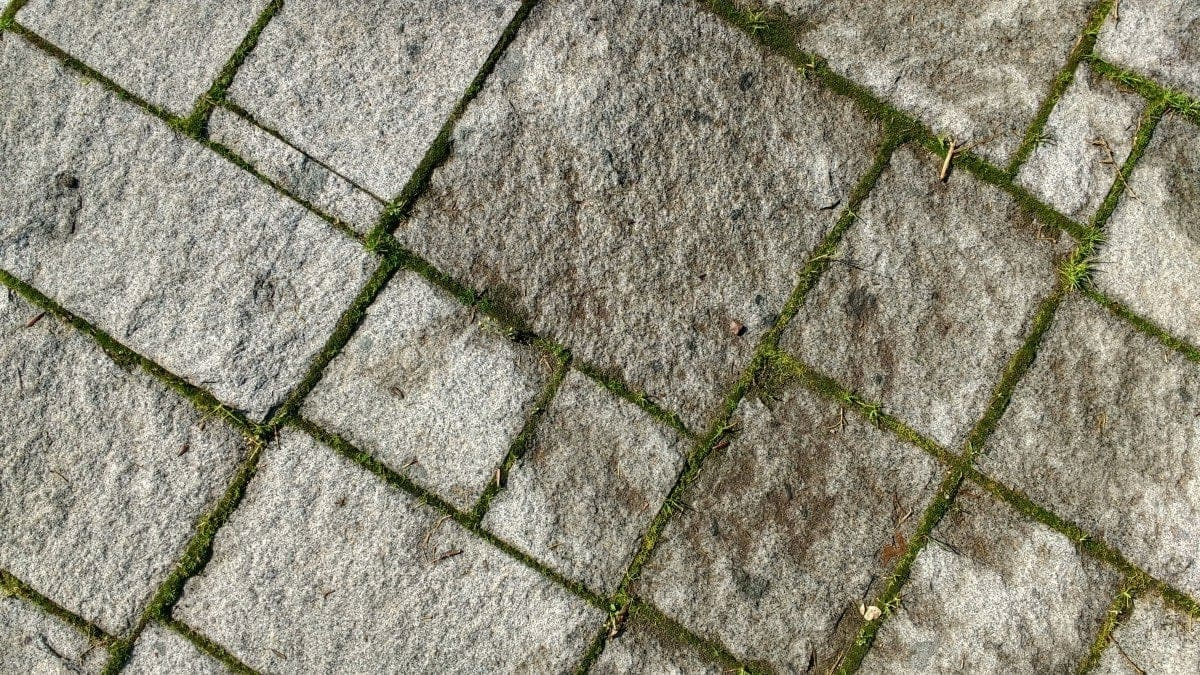 Image of a Roman stone and grass driveway