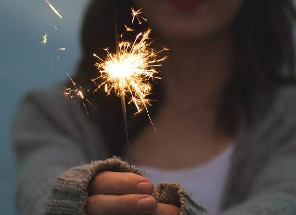 Image of a girl with a flare in her hands as a celebration