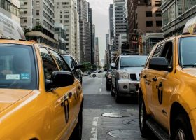 Cabs on a busy street.