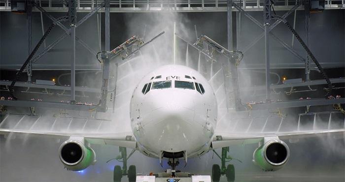 washing a plane in hangar