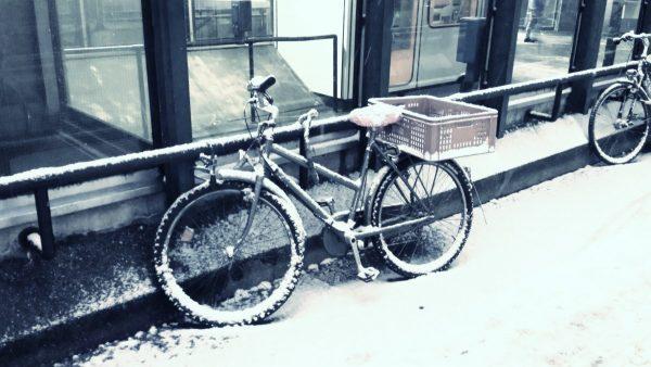 Bike on a snow sidewalk