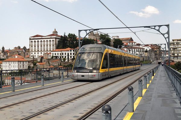 A Porto metro car as it travels through the city over the Luis I bridge