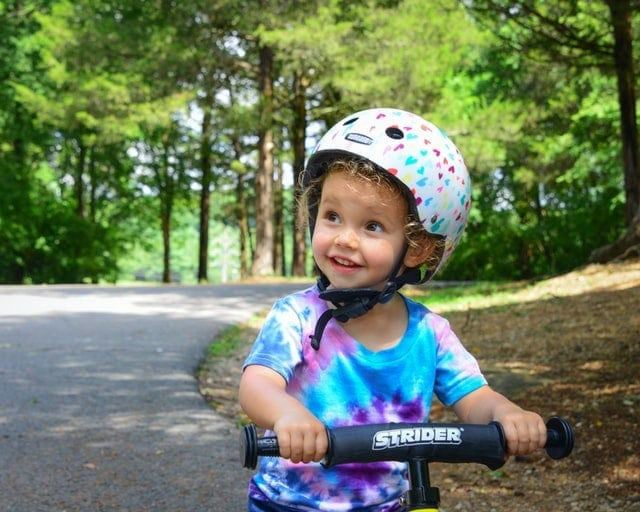 A kid riding a bicycle.
