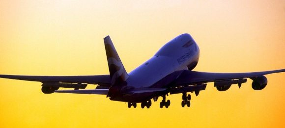 Heathrow airport third quarter results 2017 plane taking off in sunset