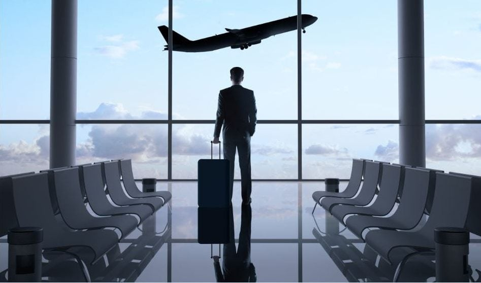 man in airport and plane in the sky