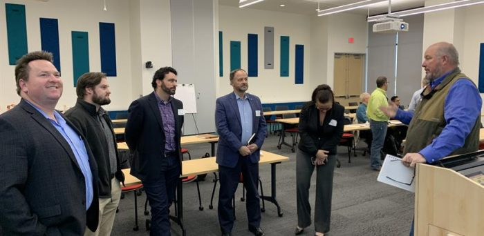 Quality Manager Hugh Brightwell (first from right) recently attended the Commercial Construction IAB board and committee meeting at the University of Houston.
